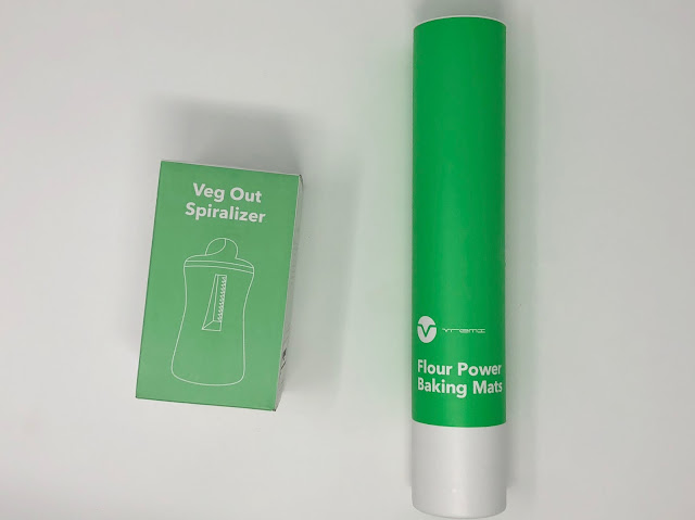 The green boxes for the handheld Vremi Spiralizer and silicone baking mats