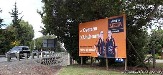 Overarm or underarm - Mitre 10 Mega billboard on SH2, just north of Clive. photograph