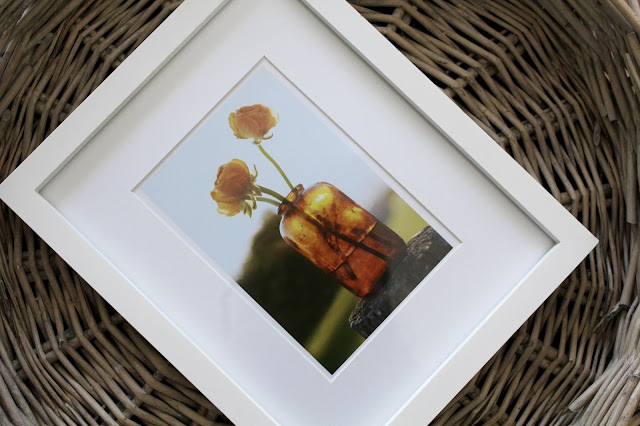 framed card on wicker tray