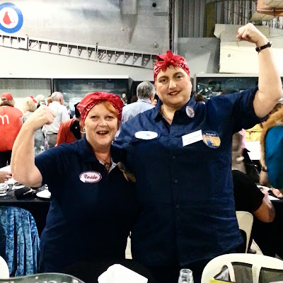 Two women dressed as Rosie the Riveter.