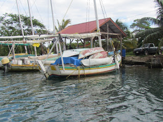 Belizean fishing smack with 5 dugout canoes aboard