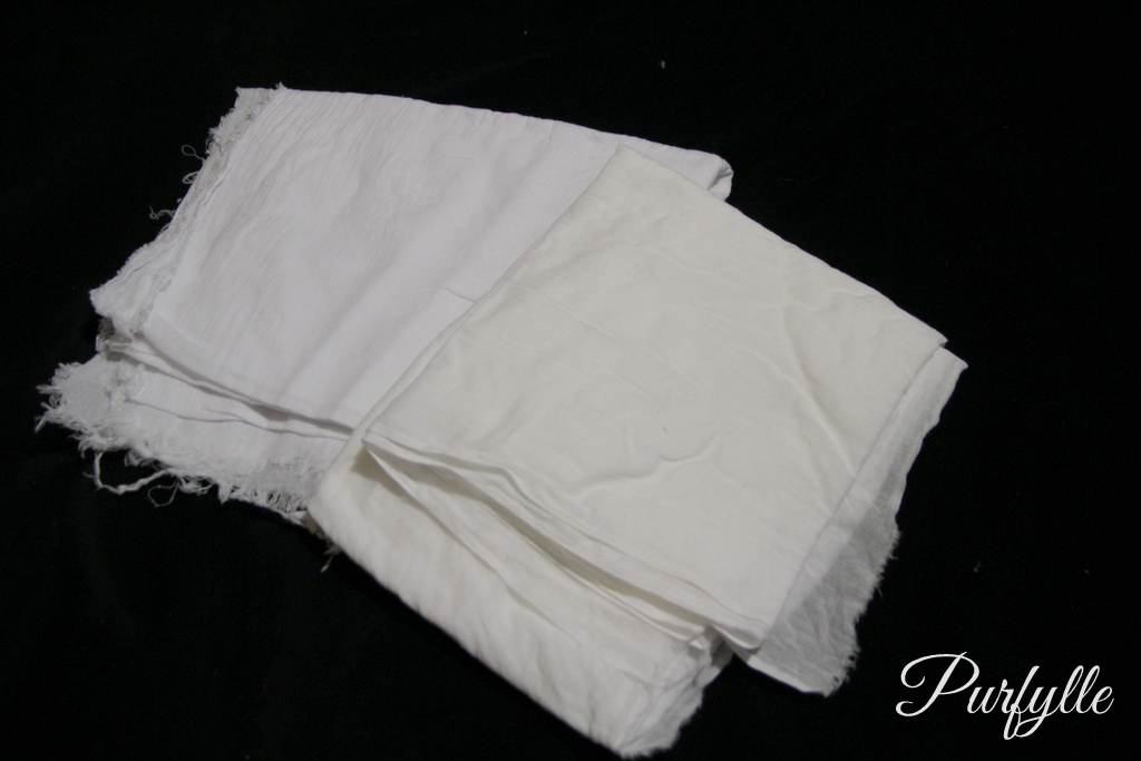 a white fabric and ivory fabric