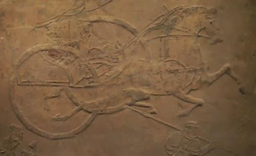 Relevo da época da dinastia Han, cujo motivo é uma carruagem (provavelmente de guerra)