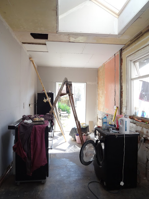 over plaster boarding the ceiling