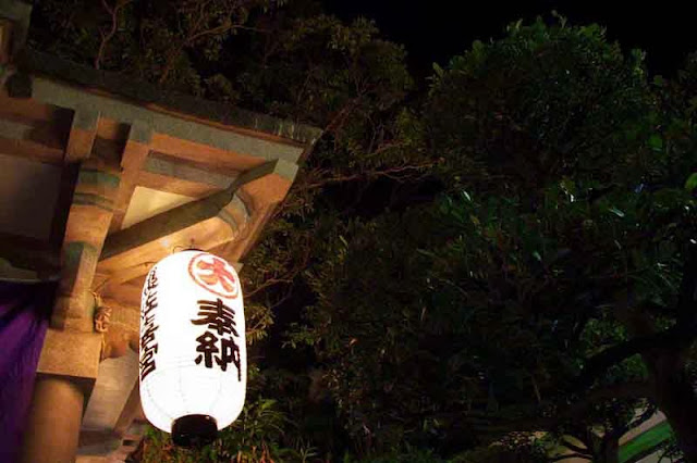 white lantern at shrine, lighted