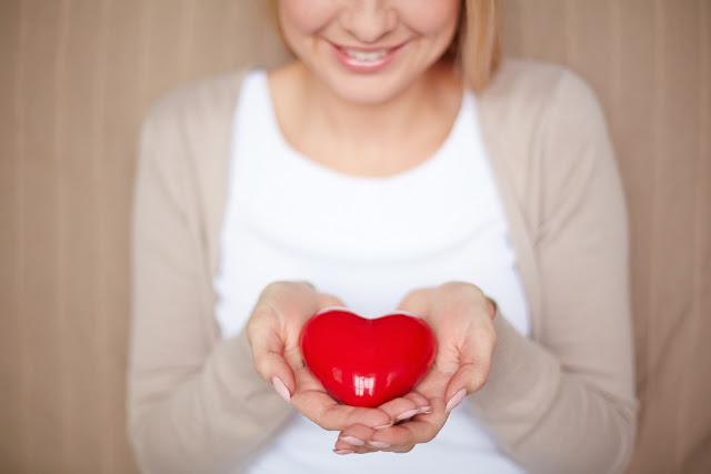http://www.freepik.com/free-photo/close-up-of-woman-holding-a-heart_863655.htm