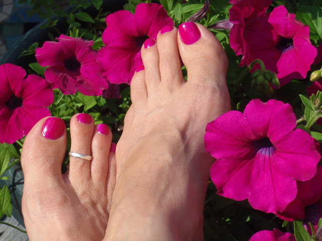 purple toe nail polish and petunias