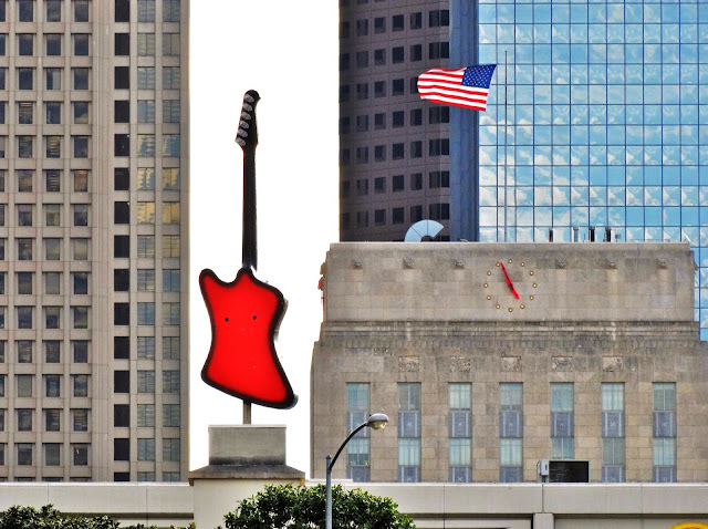 Red guitar atop Hard Rock Cafe at Bayou Place and City Hall top with clock dial