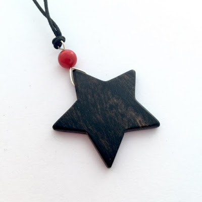 colgante estrella madera de ebano