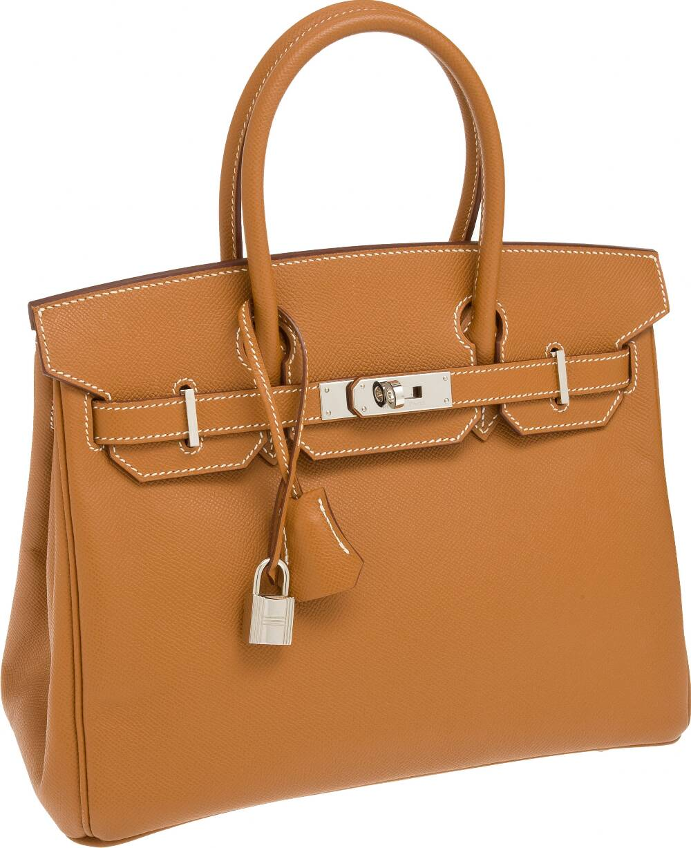 d1fbc57d913 The Hermes Birkin bag has a lock and keys. The keys are enclosed in a  leather lanyard known as a clochette