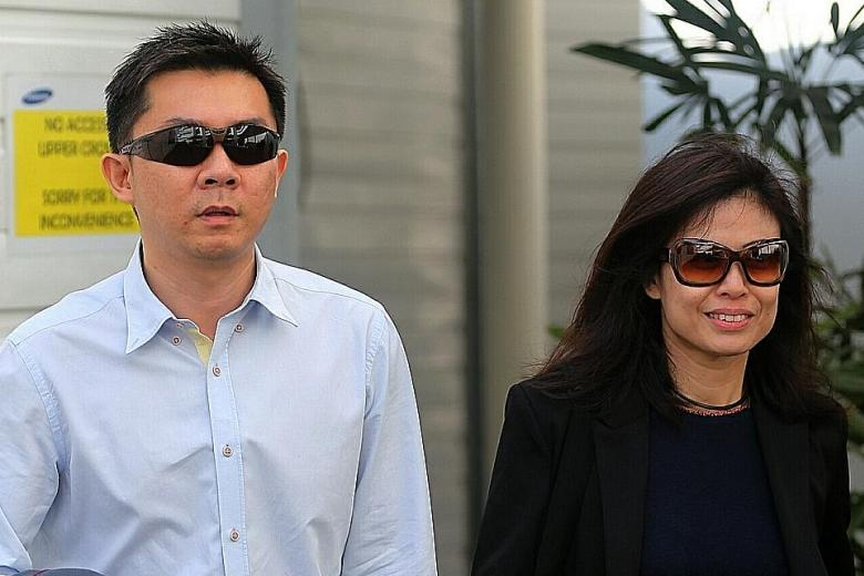 Former regional IT manager Tay Wee Kiat and his wife, Chia Yun Ling.