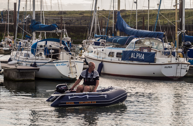Photo of Phil taking the dinghy for a test drive