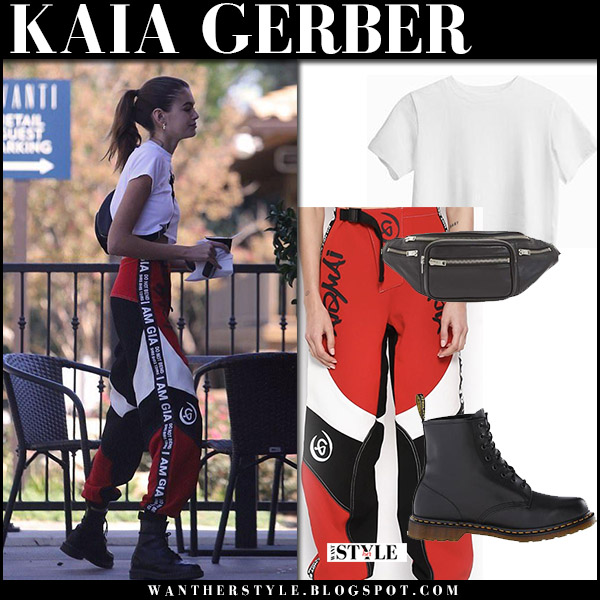 Kaia Gerber in white top hanes, red and white pants i.am.gia and black boots dr. martens model street style october 16 2017