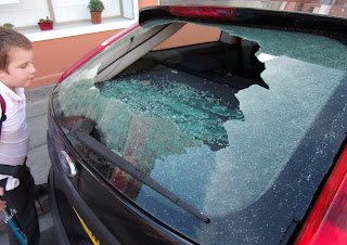 vandals broke car window ford escort