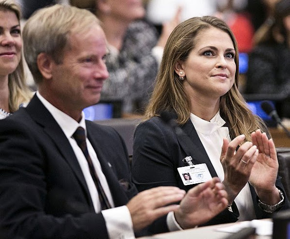 Princess Madeleine attended the seminar of World Childhood Foundation in New York. Madeleine wore bespoke woman pantsuit fashions, style