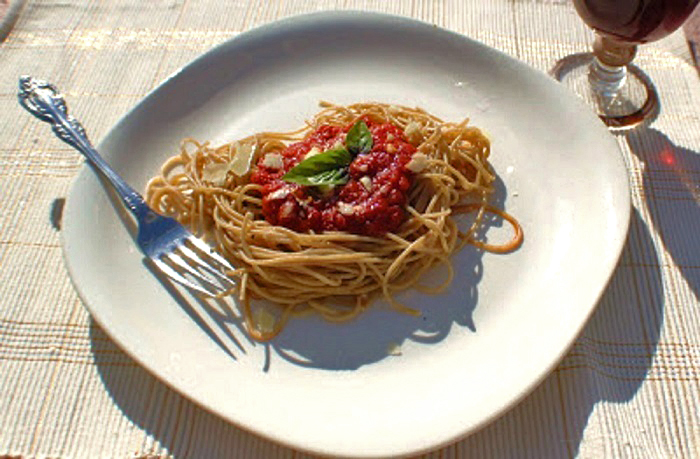 This is a plate of Spaghetti with fresh plum tomato sauce that has bits of fresh tomato, basil and sliced garlic in a quick Italian sauce.