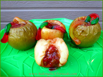 Caramel Ginger Baked Apples, for Halloween or any Fall day. Apples steamed with cinnamon and ginger are stuffed with a fun surprise and topped with a gummy worm | recipe developed by www.BakingInATornado.com | #recipe #Halloween #dessert