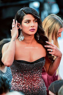 Priyanka Chopra Rocks the Rocketman Screening Cannes ina Sizzling Dark Gown .XYZ Exclusive