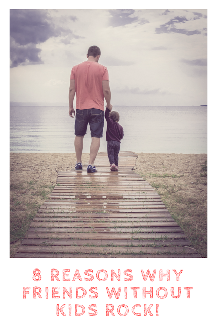 Man and child walking towards the sea with title.