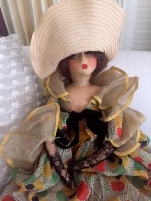 https://www.ebay.com/itm/Beautiful-1920s-antique-French-cloth-boudoir-doll-silk-face-floppy-hat/202191296121?hash=item2f138a5679:g:GWEAAOSwZrhaXpe0