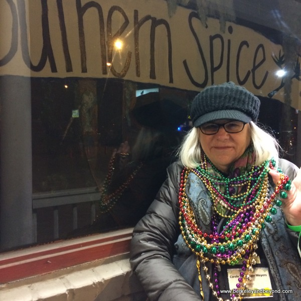 blogger Carole Terwilliger Meyers with Mardi Gras beads at Southern Spice restaurant in Lake Charles, LA