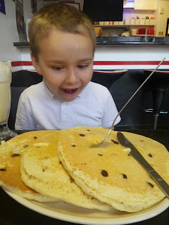 Dan Jon Jr enjoying some rather large American Style Chocolate Chip Pancakes