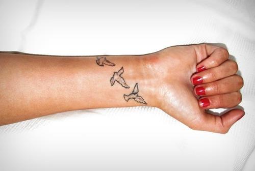 Dove Silhouette Tattoo On Wrist