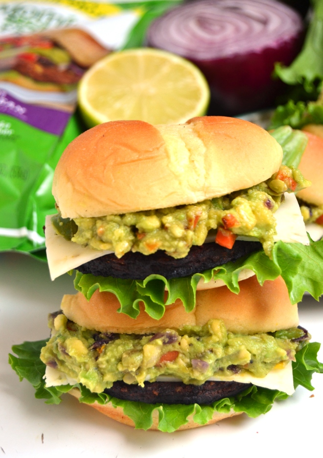 Mini Loaded Black Bean Burgers are packed with spicy black bean burgers, homemade grilled veggie loaded guacamole and pepper jack cheese all on slider buns and ready in just 10 minutes! www.nutritionistreviews.com