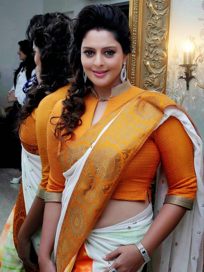 Actress Nagma Latest Hot Photos In Saree Side View Blouse And Navel Visible