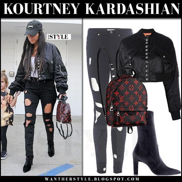 Kourtney Kardashian in black cropped bomber alexander wang jacket, ripped jeans with Louis Vuitton mini backpack what she wore