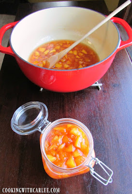 peach sauce in pot and some in jar