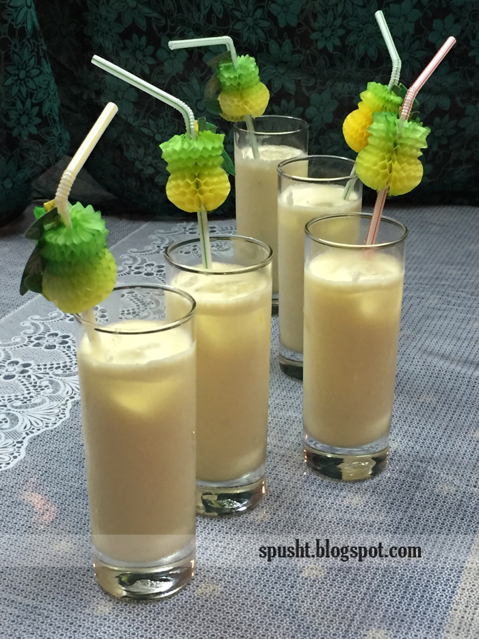 tropical drink virgin pina colada with fancy pineapple straws