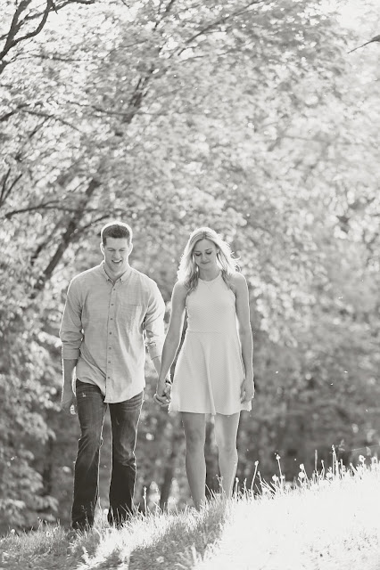black and white of couple walking in field in sioux city