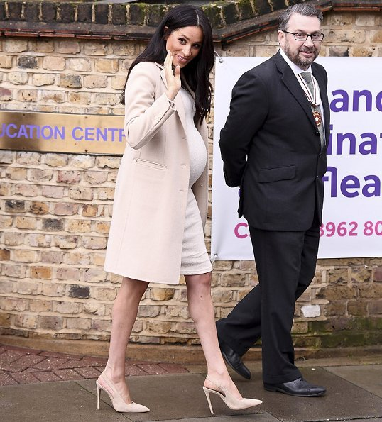 Meghan Markle wore Emporio Armani coat, and H&M Mama fine-knit dress, Paul Andrew pumps and carrie Stella McCartney bag