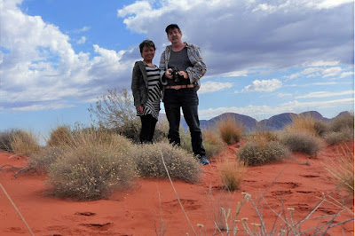 Graham Warrender and wife Juliet pose on a sand dune.