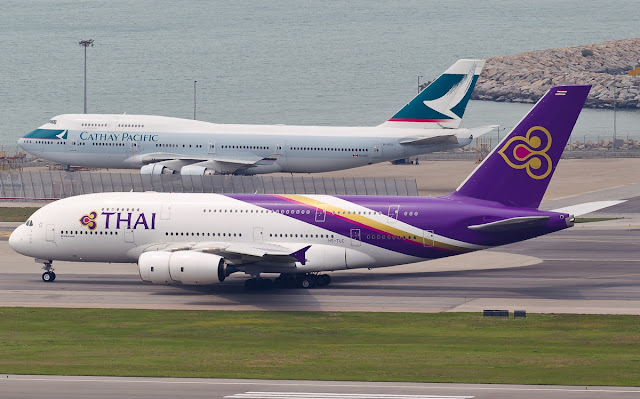 Thai Airways A380-800 Alongside Cathay Pacific Boeing 747-400