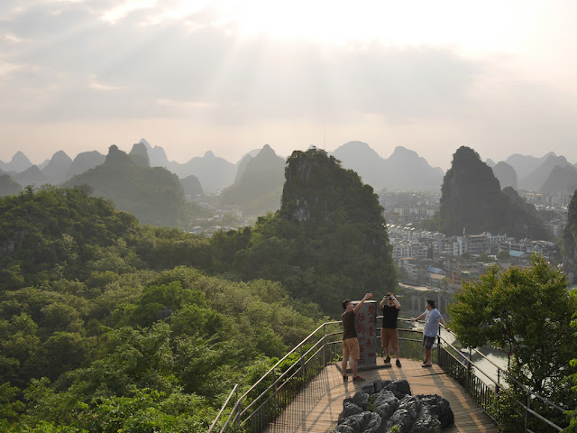 people taking photographs on Bright Moon Peak at Diecai HIll (叠彩山) in Guilin