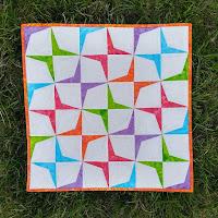 Modern batik mini quilt