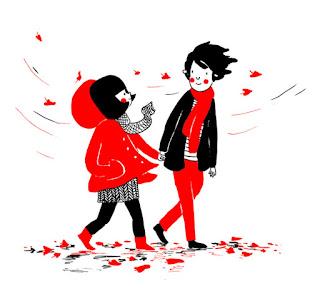 Caminando tomados de la mano en un día de otoño