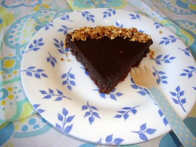 porción Tarta de almendras y chocolate