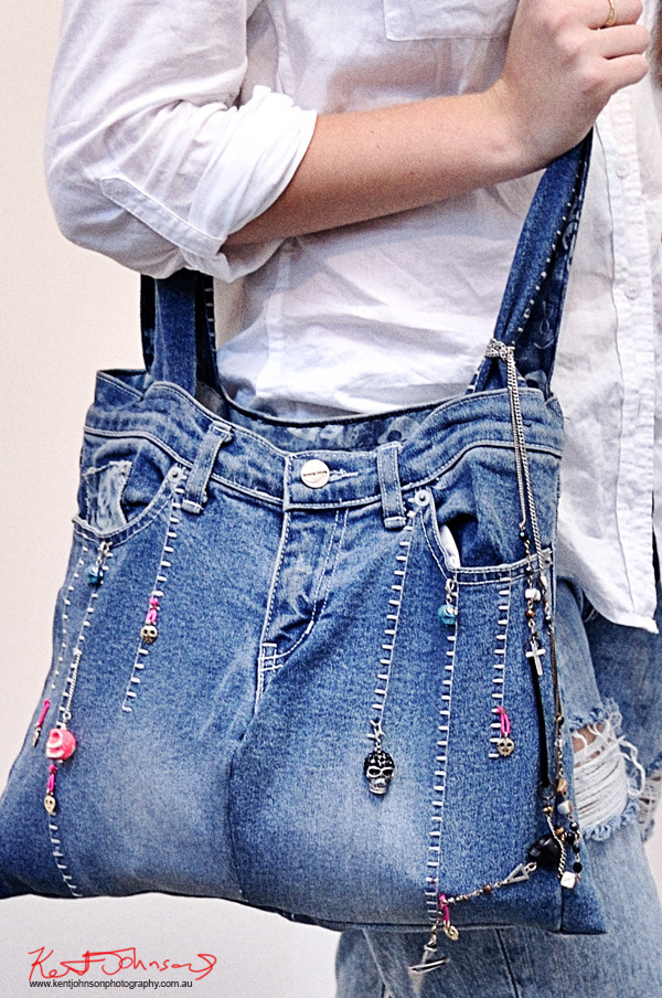 Detail - Home made, Upcycled  denim tote bag with hand stitching and funky skulls, worn jeans, Blundstone  boots and white shirt. Street Fashion Sydney by Kent Johnson.