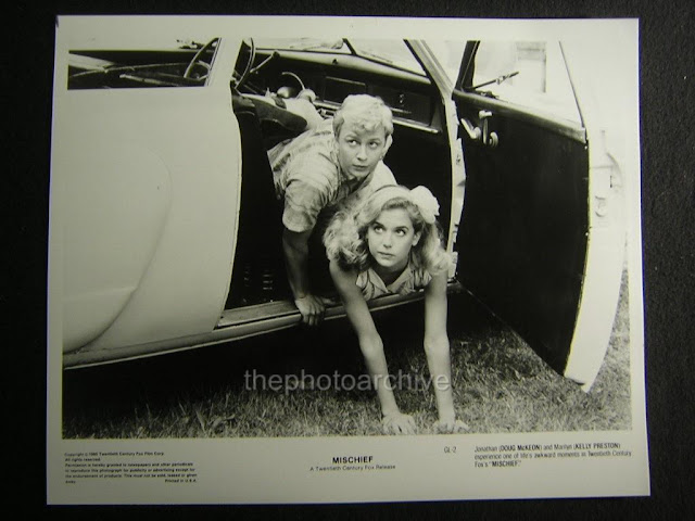 original still of Kelly Preston and Doug McKeon falling out of their car