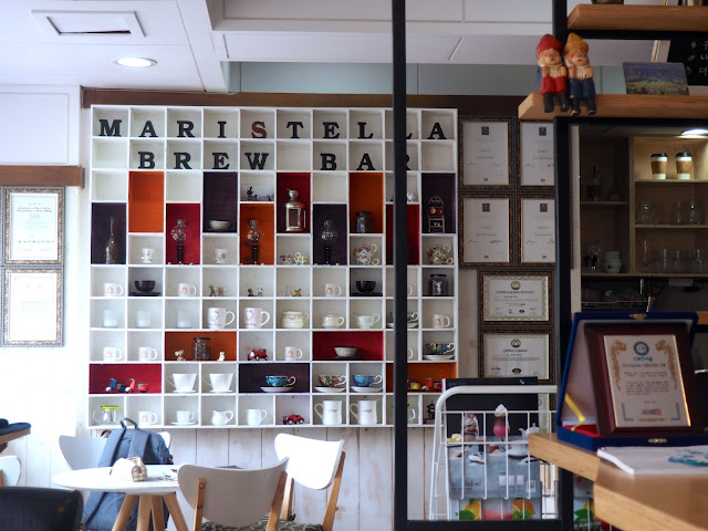 Cafe interior details - shelf display of coffee cups in Marisstella cafe in Myeongnyun, Busan, South Korea