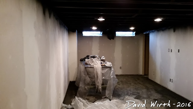 finished painting ceiling black, joists, drywall, air sprayer, paint sprayer