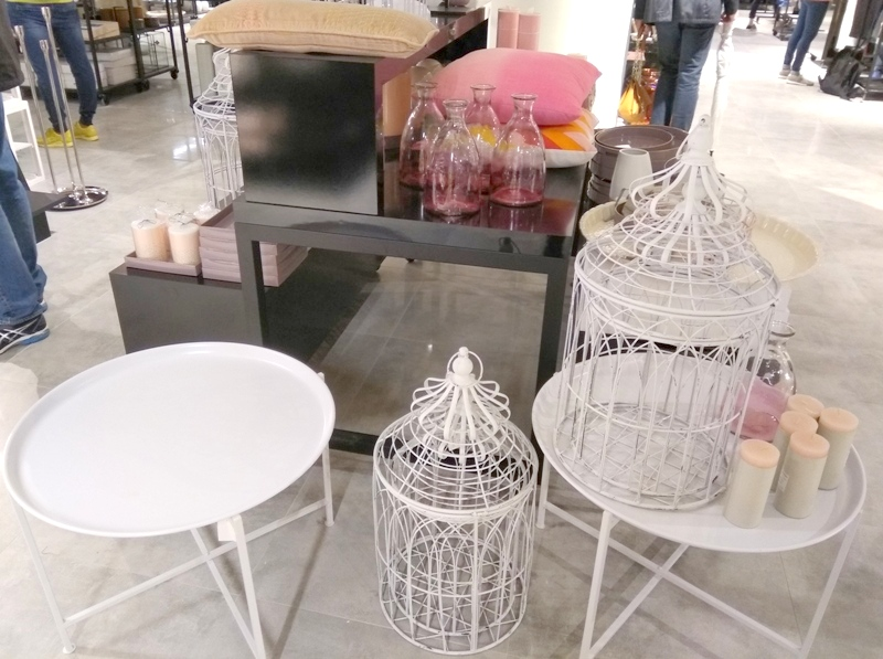 Saks Off 5th Rotterdam Netherlands interior bird cages table candles cushions glass bottles