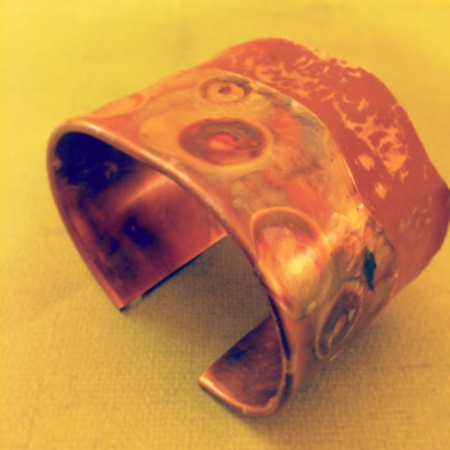 Heat and paint patina on a copper fold formed cuff