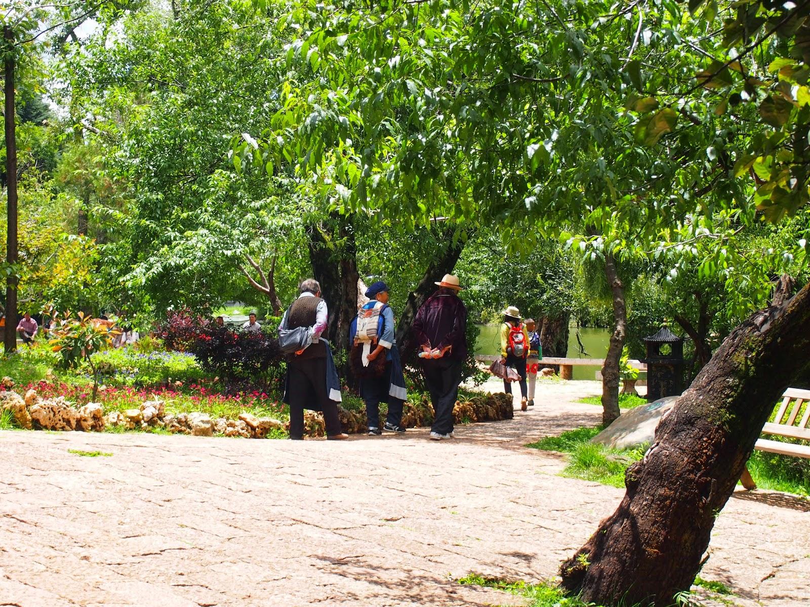 Naxi women and men walking in Heilongtan park