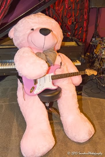 Lady Cuddles wailing on a pink Fender guitar