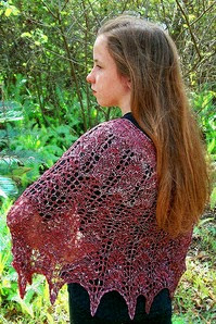 http://www.ravelry.com/patterns/library/petit-allegro-lace-ponchette---poncho