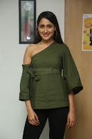 Pragya Jaiswal in a single Sleeves Off Shoulder Green Top Black Leggings promoting JJN Movie at Radio City 10.08.2017 060.JPG